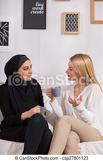 Multicultural friends drinking coffee - csp27801123