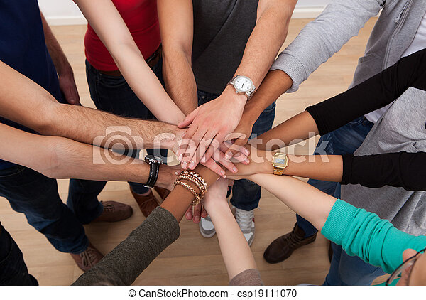 Multiethnic College Students Stacking Hands - csp19111070