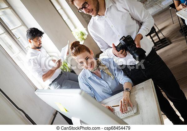 Multiethnic startup business team on meeting in modern bright office interior brainstorming - csp68454479