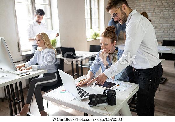 Multiethnic startup business team on meeting in modern bright office interior brainstorming - csp70578560
