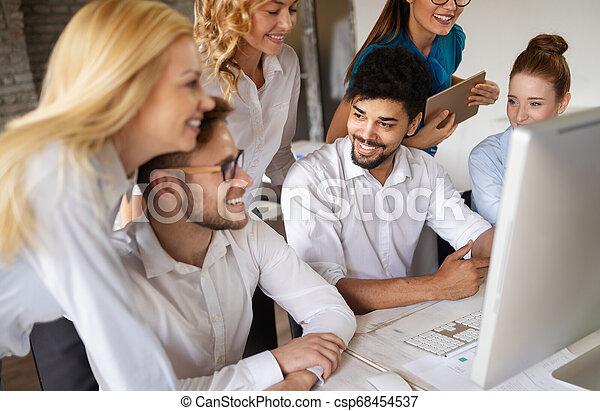 Multiethnic startup business team on meeting in modern bright office interior brainstorming - csp68454537