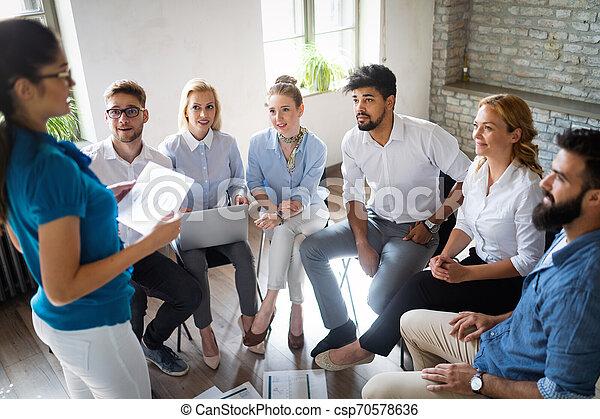 Multiethnic startup business team on meeting in modern bright office interior brainstorming - csp70578636