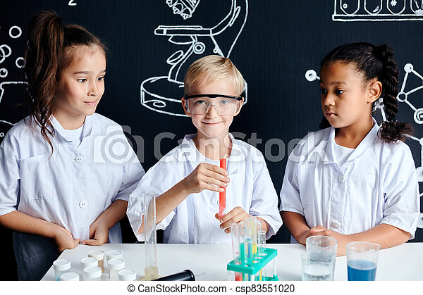 Multiracial diverse kids with test tubes studying chemistry at school laboratory - csp83551020