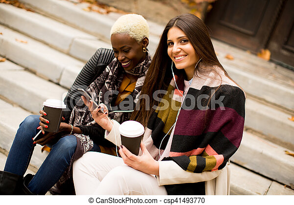 Multiracial friends outdoors - csp41493770