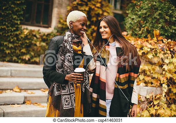 Multiracial friends outdoors - csp41463031
