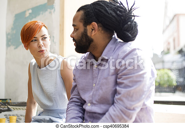 Multiracial friends talking - csp40695384