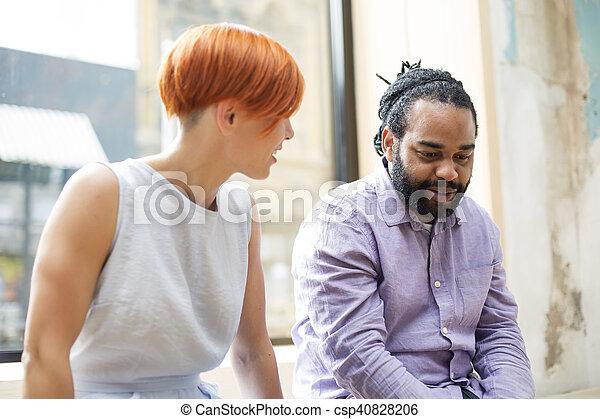 Multiracial friends talking - csp40828206