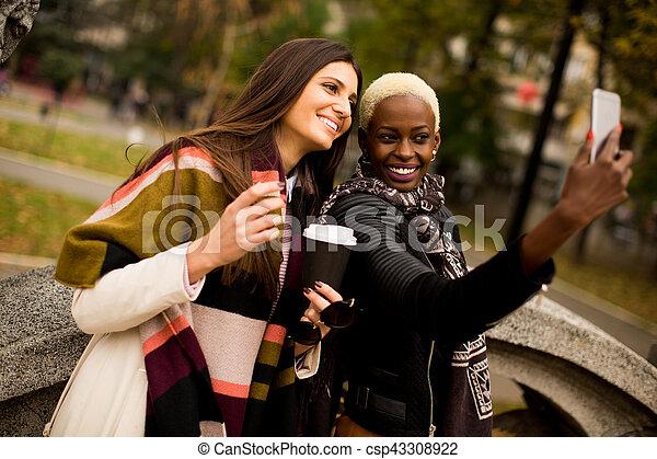 Multiracial friendship - csp43308922