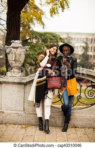 Multiracial friendship - csp43310046
