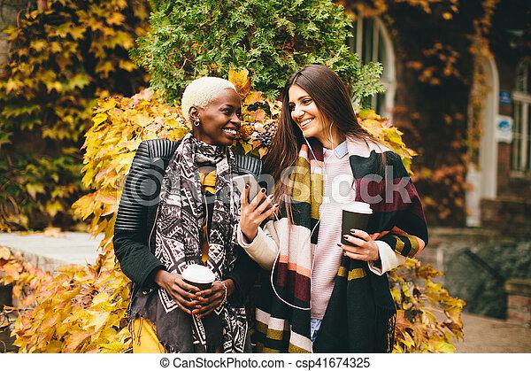 Multiracial young women outdoor - csp41674325