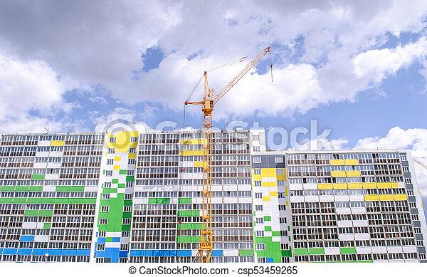 Multistorey building and construction cranes - csp53459265