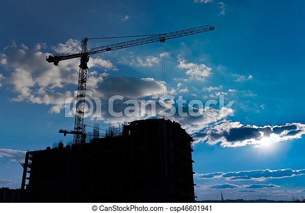Multistorey housing under construction and industrial construction cranes - csp46601941