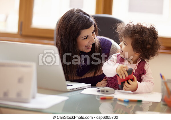 Multitasking mother with her daughter - csp6005702