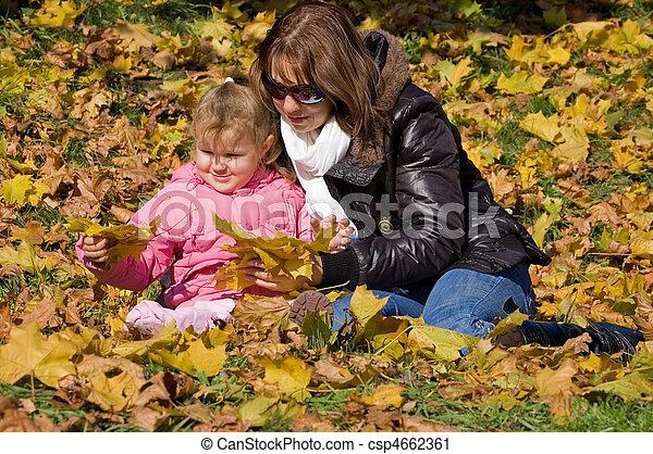 Mum with a daughter in autumn park - csp4662361