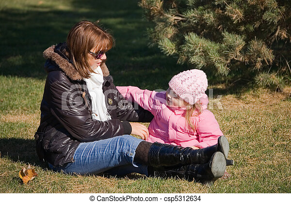 Mum with a daughter in autumn park - csp5312634