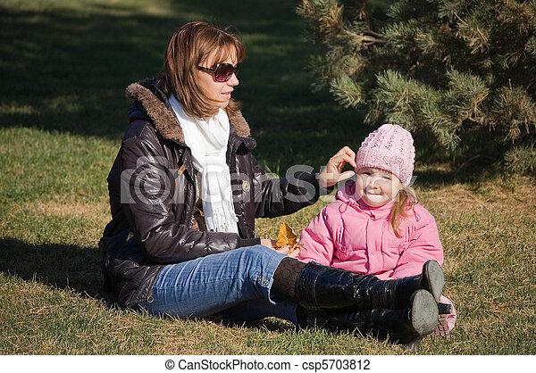 Mum with a daughter in autumn park - csp5703812