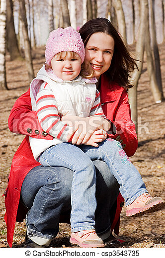 Mum with a daughter in park - csp3543735