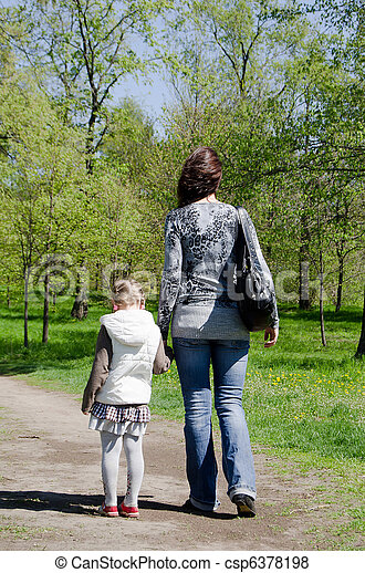 Mum with a daughter on rest in park - csp6378198