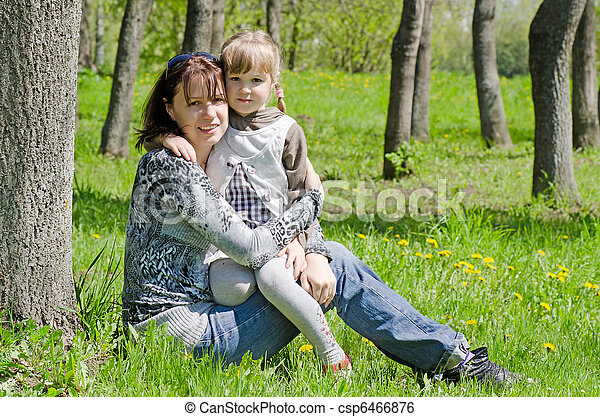 Mum with a daughter on rest in park - csp6466876