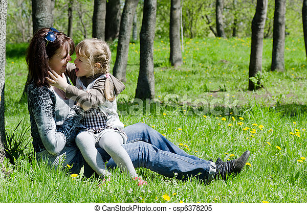 Mum with a daughter on rest in park - csp6378205