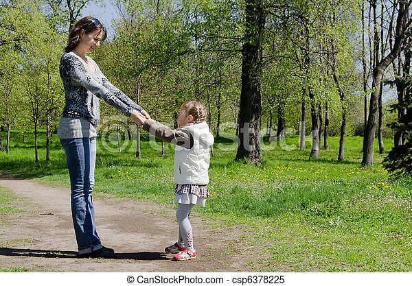 Mum with a daughter on rest in park - csp6378225