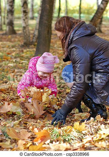 Mum with a daughter walk in autumn park - csp3338966