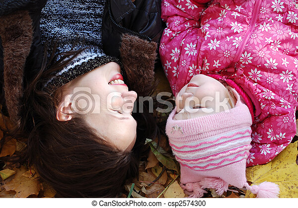 Mum with a daughter walk in autumn park - csp2574300