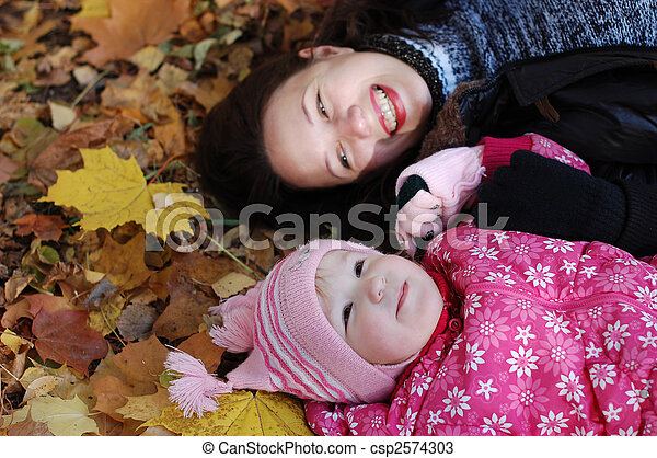 Mum with a daughter walk in autumn park - csp2574303