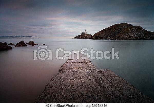 Mumbles Beach and Lighthouse - csp42945246