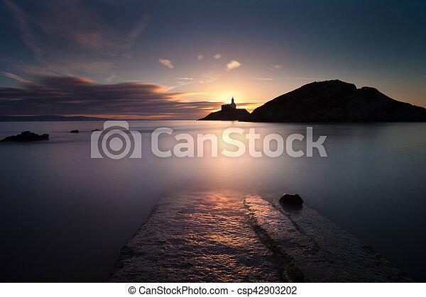 Mumbles lighthouse at dawn - csp42903202