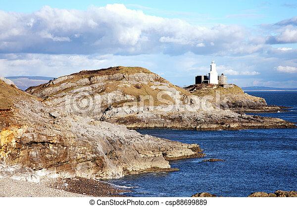 Mumbles lighthouse Bracelet Bay on the Gower Peninsular West Glamorgan Wales UK - csp88699889