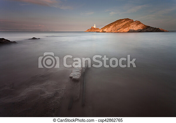 Mumbles lighthouse Swansea - csp42862765