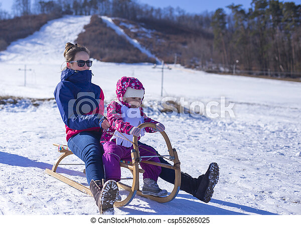 Christmas Vacation Sled.Mummy Is Sledging With Her Baby