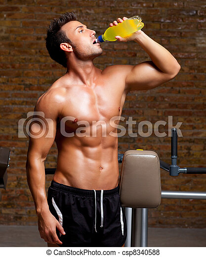muscle man at gym relaxed with energy drink - csp8340588