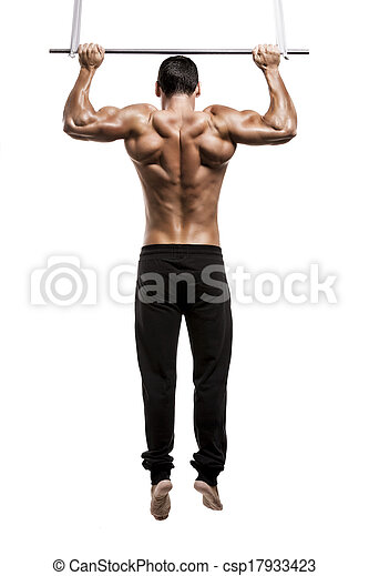 Muscle man in studio making elevations, isolated over a white background - csp17933423