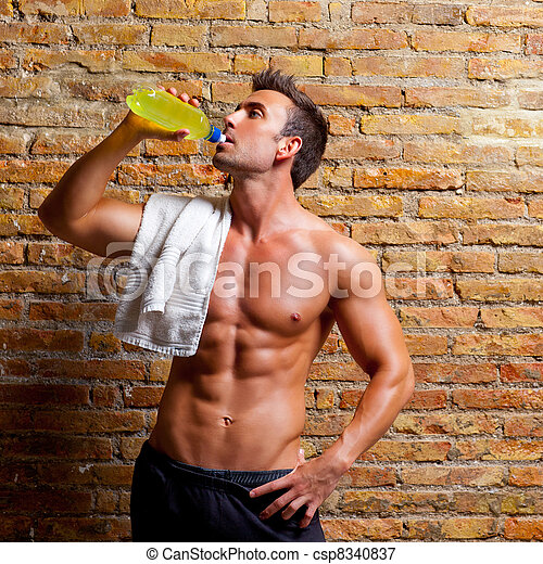 muscle shaped man at gym relaxed drinking - csp8340837