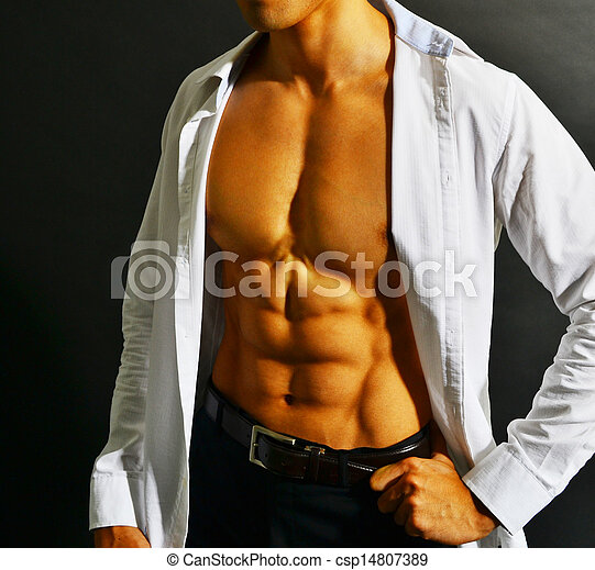 Muscular asian businessman - csp14807389