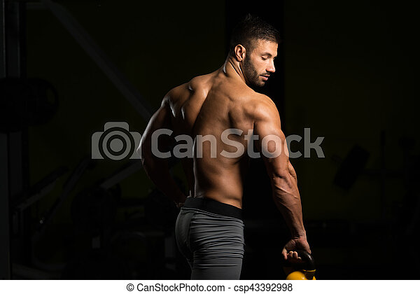 Muscular Man Exercising With Kettle-bell - csp43392998