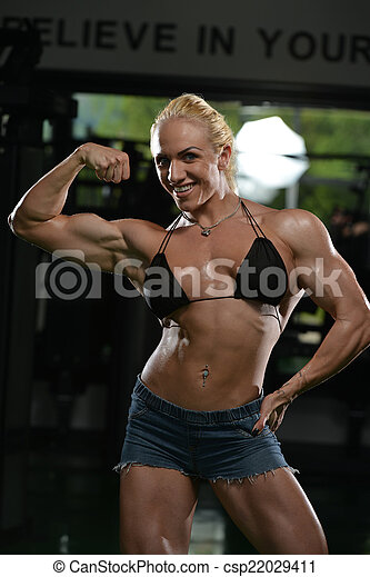 Female sexy mature biceps flexing