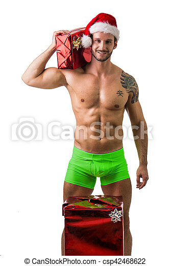 muscular young man in santa claus hat with christmas gift csp42468622