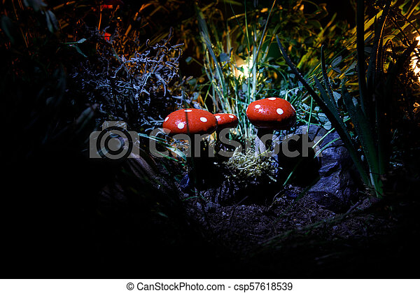 Mushroom. Fantasy Glowing Mushrooms in mystery dark forest close-up. Amanita muscaria, Fly Agaric in moss in forest. Magic mushrooms background - csp57618539