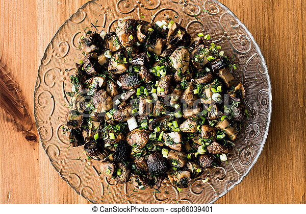 Mushrooms Salad in glass bowl. - csp66039401