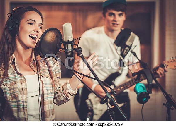 Music band performing in a recording studio  - csp29240799