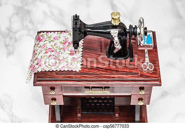 Music box with a shape of vintage sewing machine Music box with a Beauteous Sewing Machine Music Box