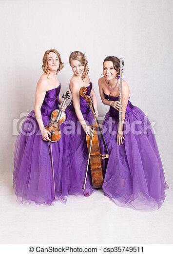 musical trio in purple dresses - csp35749511
