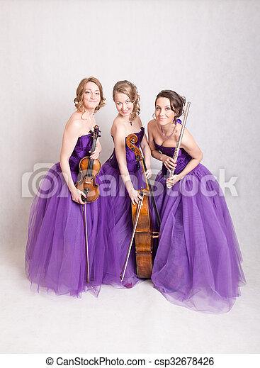musical trio in the studio - csp32678426