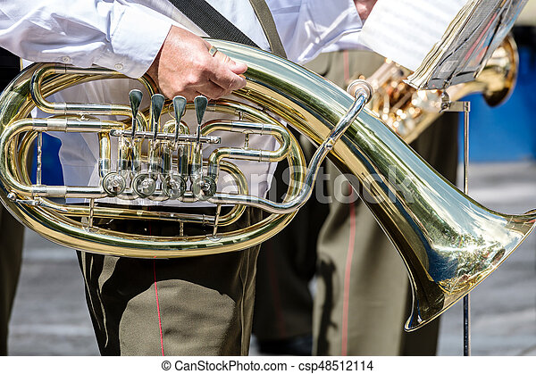 musician of military brass band holding tuba in his hand - csp48512114