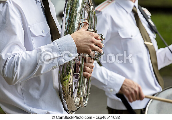 musician of military orchestra playing tuba during brass bands festival - csp48511032