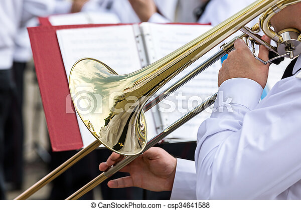 musician of military orchestra plays his trombone - csp34641588