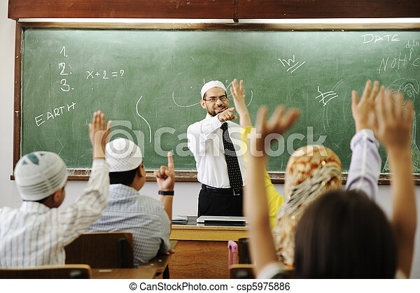muslim male teachers in classroom with childrens stock
